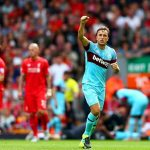 LIVERPOOL, ENGLAND - AUGUST 29: Mark Noble of West Ham United celebrates scoring his team's second goal from the penalty spot during the Barclays Premier League match between Liverpool and West Ham United at Anfield on August 29, 2015 in Liverpool, England.  (Photo by Clive Mason/Getty Images)